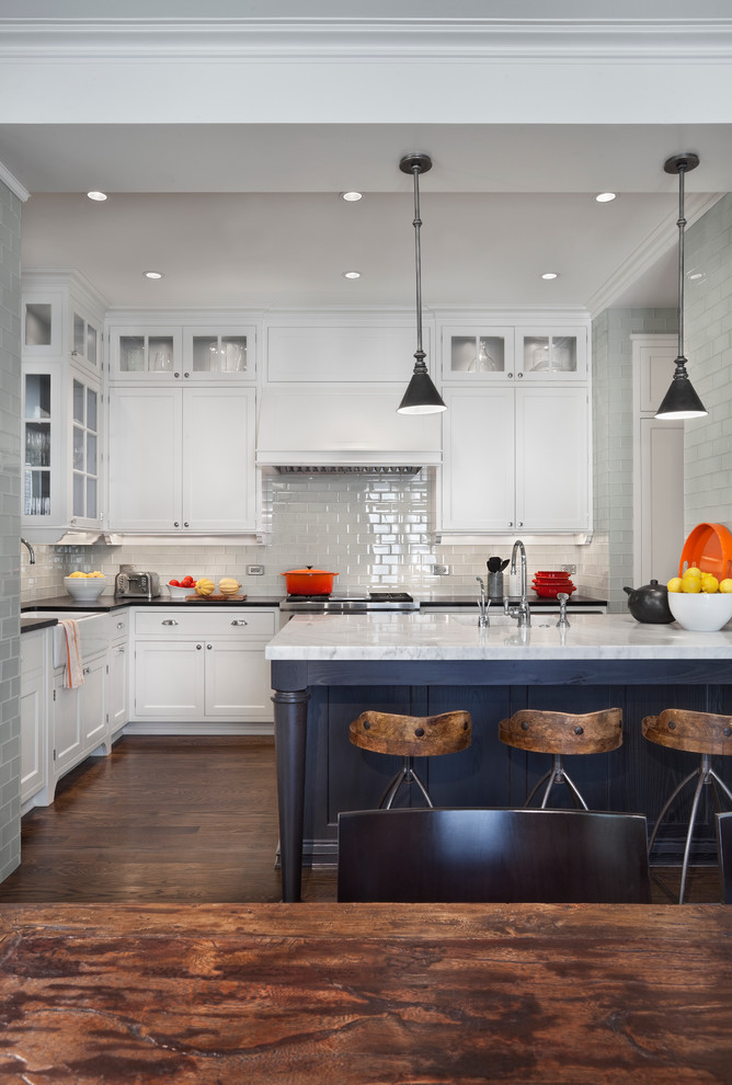 Transitional kitchen photo in Chicago with a farmhouse sink, white cabinets, white backsplash and subway tile backsplash