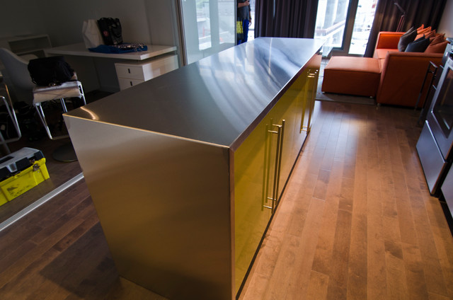 ... Island with custom Thermofoil doors and Stainless steel countertop