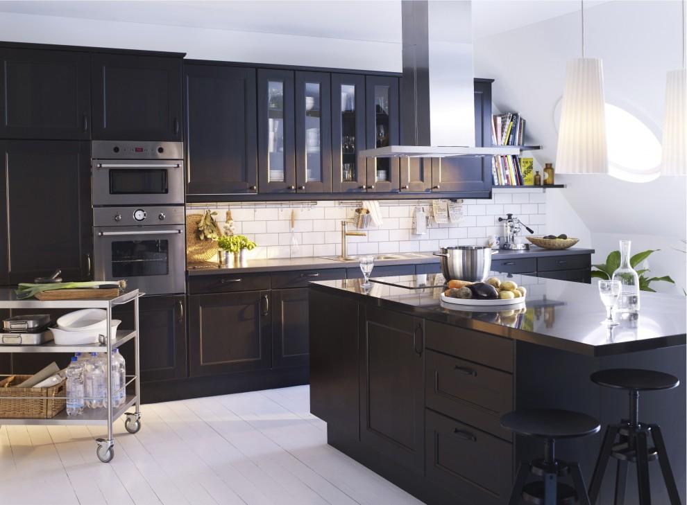 Kitchen - modern kitchen idea in Other with black cabinets, stainless steel countertops, white backsplash and subway tile backsplash