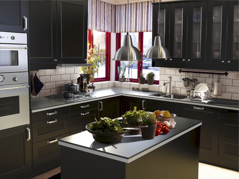 Inspiration for a contemporary kitchen remodel in Other with recessed-panel cabinets, black cabinets, white backsplash and subway tile backsplash