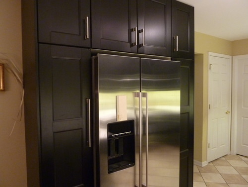 How is the fridge flush with the cabinets? Is there a recess in wall?