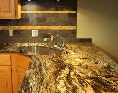 Incendio Granite Kitchen w/ Limestone backsplash traditional-kitchen