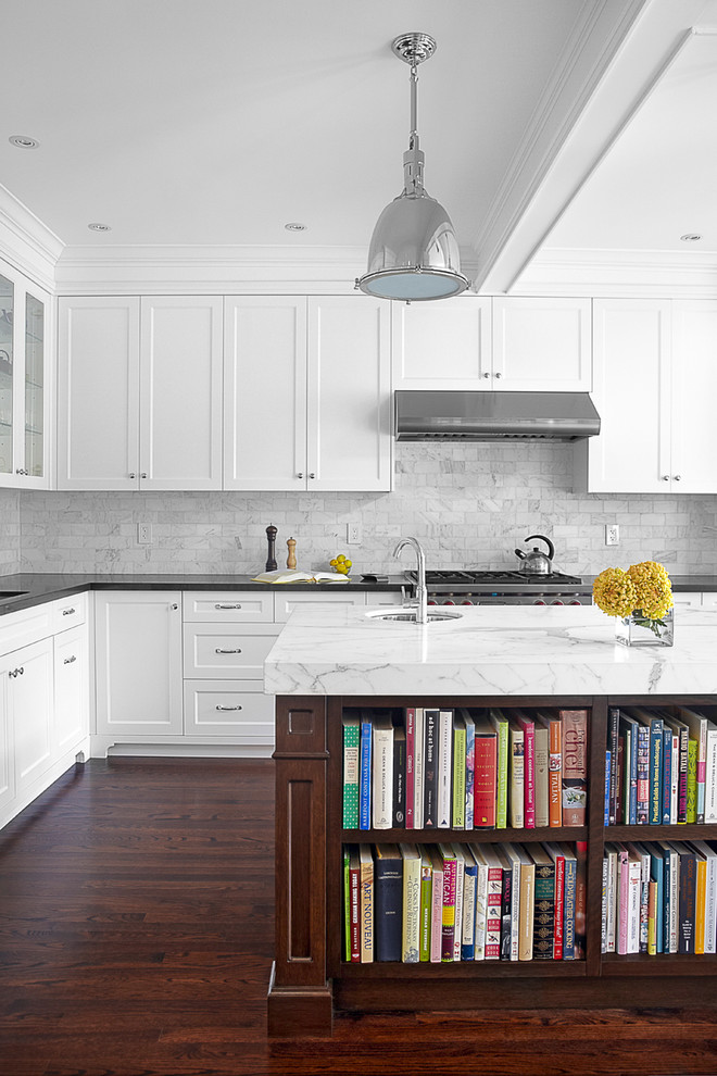 Large elegant l-shaped dark wood floor eat-in kitchen photo in Toronto with recessed-panel cabinets, white cabinets, marble countertops, stone tile backsplash, gray backsplash, an undermount sink, stainless steel appliances and an island