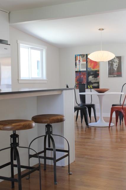 industrial bar stools at modern kitchen island