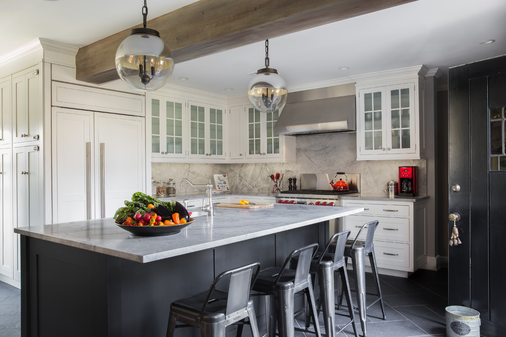 Inspiration for a mid-sized transitional l-shaped slate floor and gray floor kitchen remodel in New York with white cabinets, quartzite countertops, gray backsplash, stone slab backsplash, an island, an undermount sink, glass-front cabinets and paneled appliances