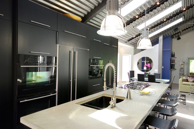 Contemporary black kitchen with concrete counters and stainless steel fixtures - Contemporary ...