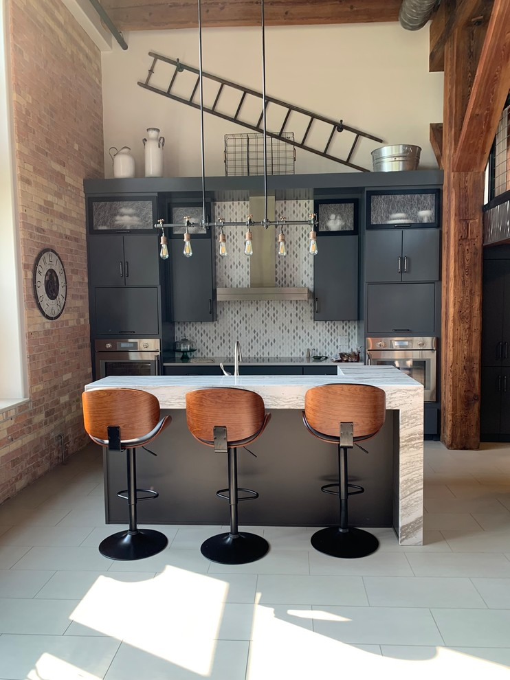 Example of a mid-sized urban single-wall porcelain floor and gray floor open concept kitchen design in Minneapolis with flat-panel cabinets, gray cabinets, quartz countertops, marble backsplash, stainless steel appliances, two islands and white countertops