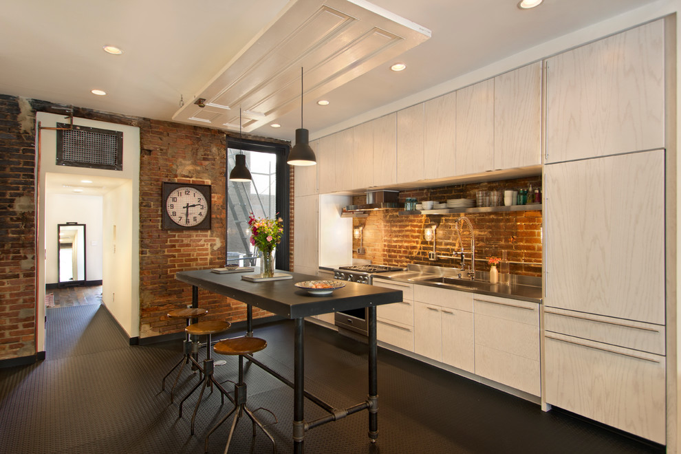 Urban single-wall kitchen photo in DC Metro with flat-panel cabinets, light wood cabinets, stainless steel countertops, an island, an integrated sink, stainless steel appliances and brown backsplash