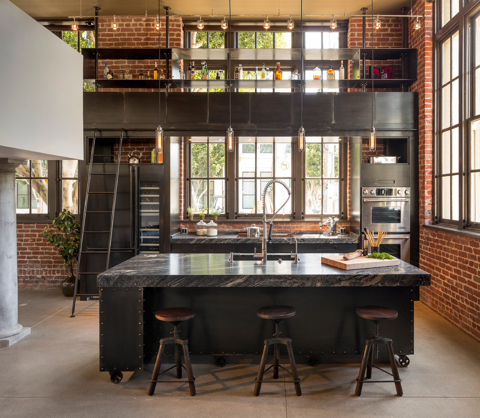 Urban galley concrete floor eat-in kitchen photo in Other with flat-panel cabinets, stainless steel appliances and an island