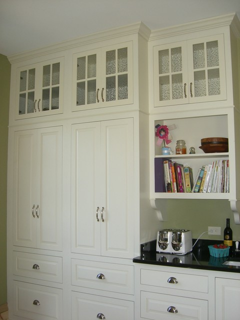 inset doors and floor to ceiling built-ins,  in keeping with this 1830's beauty traditional-kitchen