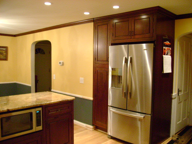Inset kitchen cabinets cherry cabinetry cliqstudios for Kitchen cabinets qatar