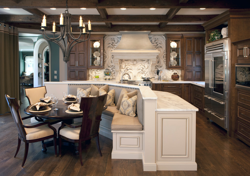 Inspiration for a large timeless l-shaped dark wood floor eat-in kitchen remodel in Atlanta with stainless steel appliances, marble countertops, raised-panel cabinets, dark wood cabinets, an island and white countertops