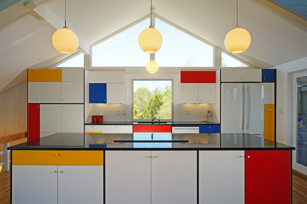 Example of a mid-century modern galley medium tone wood floor kitchen design in Boston with flat-panel cabinets, white backsplash, subway tile backsplash, white appliances and an island