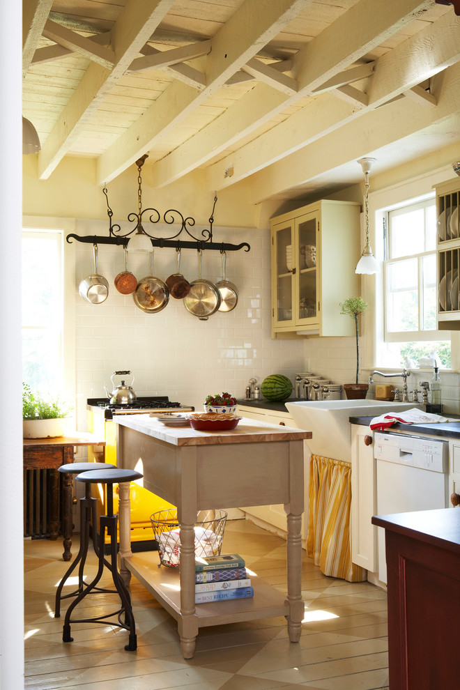 Mid-sized cottage l-shaped eat-in kitchen photo in Other with a farmhouse sink, glass-front cabinets, beige cabinets, white backsplash, subway tile backsplash, an island and white appliances