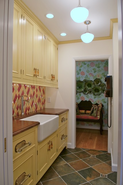Example of a classic kitchen design in Cincinnati with yellow cabinets