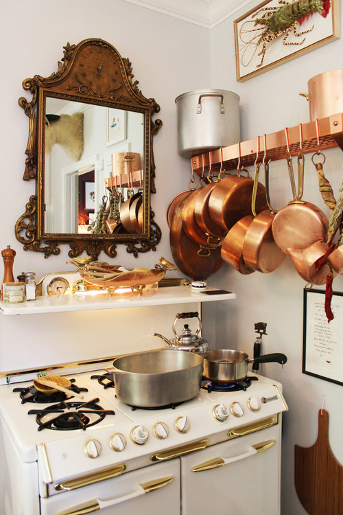 Copper Pots And Framed Lobsters