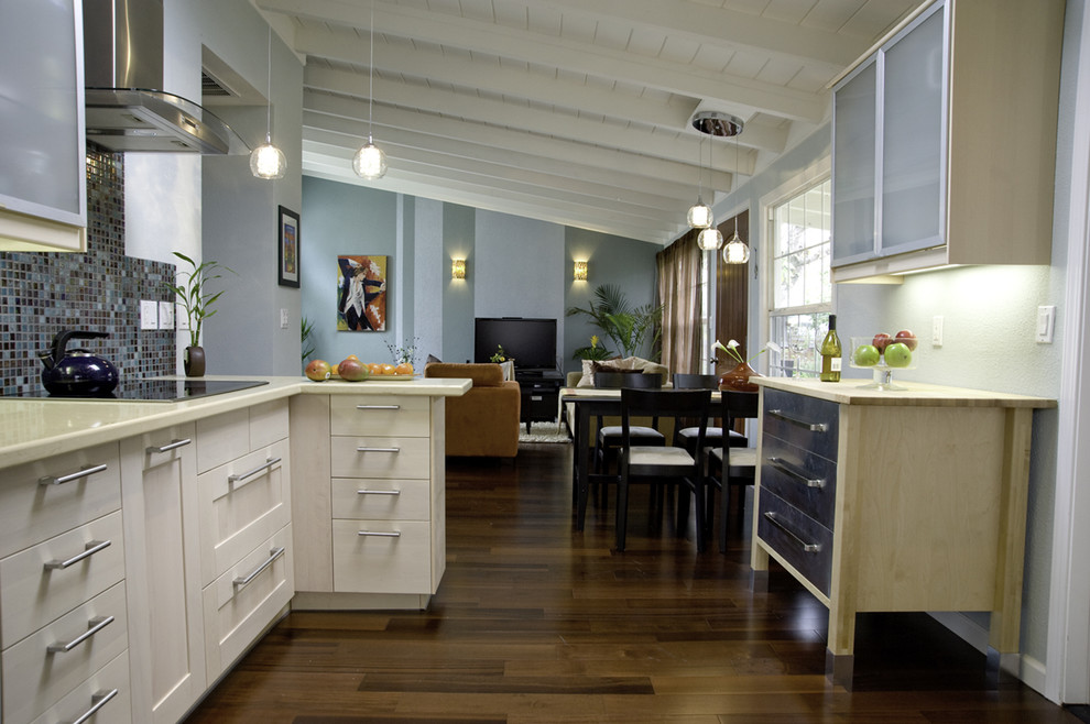 Example of a mid-sized trendy l-shaped dark wood floor open concept kitchen design in San Francisco with shaker cabinets, multicolored backsplash, mosaic tile backsplash, quartz countertops, stainless steel appliances, two islands and an undermount sink