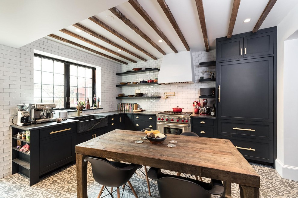 Mid-sized cottage l-shaped cement tile floor and brown floor eat-in kitchen photo in DC Metro with a farmhouse sink, shaker cabinets, black cabinets, white backsplash, subway tile backsplash, stainless steel appliances and no island