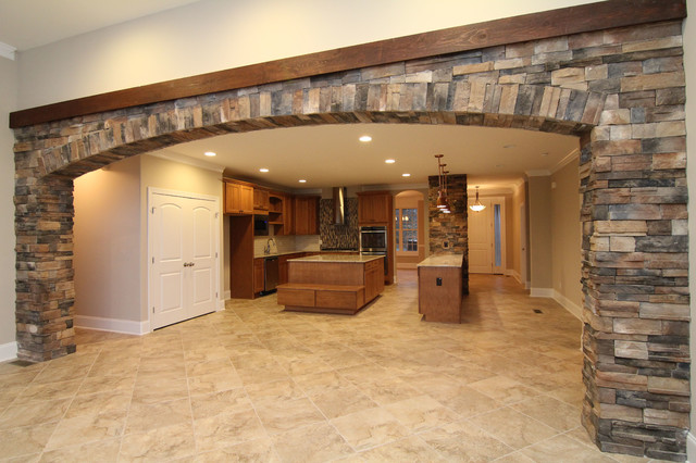 Interior Stone Archway Between Kitchen and Great Room - Transitional ...