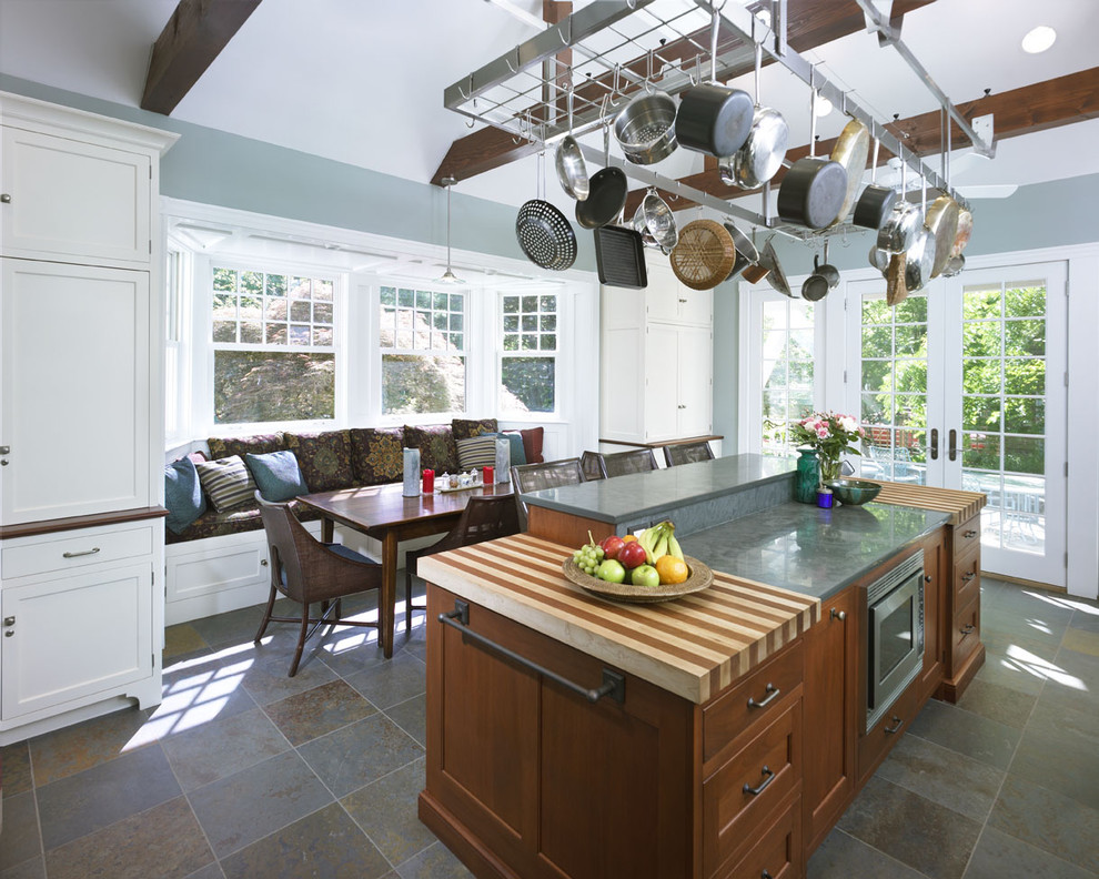 Kitchen - transitional kitchen idea in Philadelphia with wood countertops, recessed-panel cabinets and white cabinets