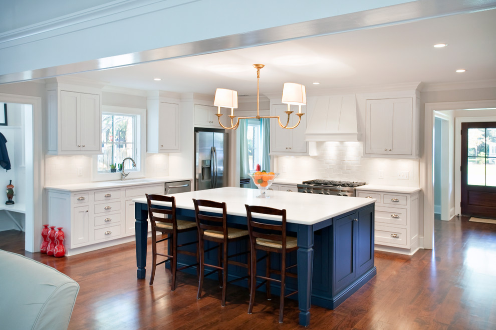 Open concept kitchen - traditional l-shaped open concept kitchen idea in San Francisco with recessed-panel cabinets, white cabinets, white backsplash, subway tile backsplash and stainless steel appliances
