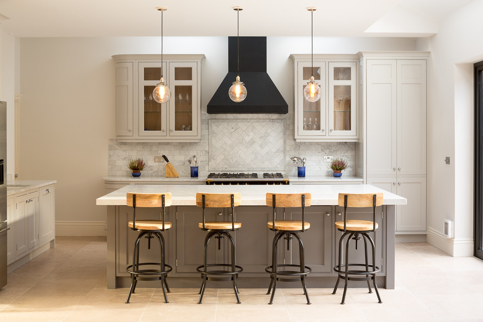 Inspiration for a large transitional l-shaped porcelain tile eat-in kitchen remodel in London with shaker cabinets, gray cabinets, an island and ceramic backsplash