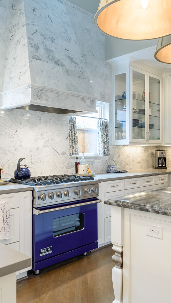 Inspiration for a timeless light wood floor kitchen remodel in Dallas with recessed-panel cabinets, white cabinets, gray backsplash, colored appliances and an island