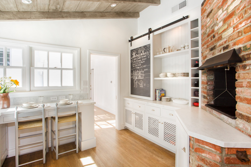 Inspiration for a timeless kitchen remodel in Los Angeles with open cabinets and white cabinets