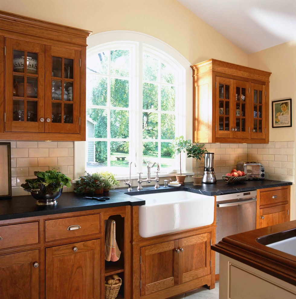 Ornate kitchen photo in New York with subway tile backsplash, a farmhouse sink and soapstone countertops