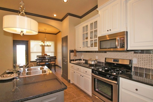 Ironstone model home traditional kitchen other metro for Model home kitchens