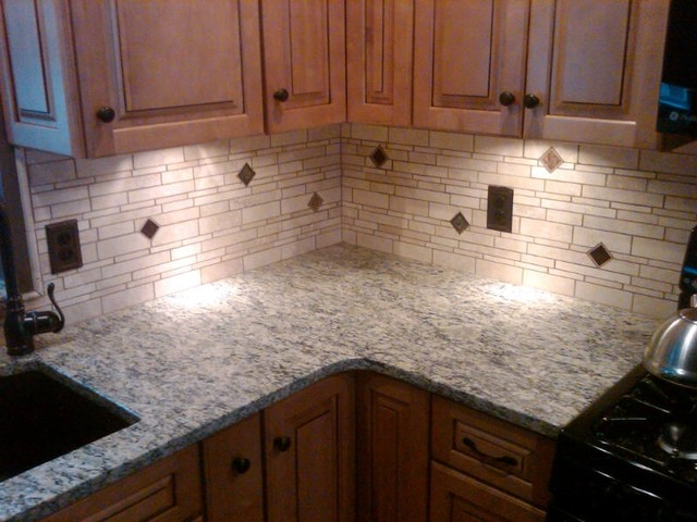 Irregular light travertine backsplash traditional kitchen other metro by glens falls - Backsplash designs travertine ...