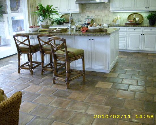 """Irvine Model Homes - Artillo 12""""x12"""" concrete tiles in Spanish Cotto color"""