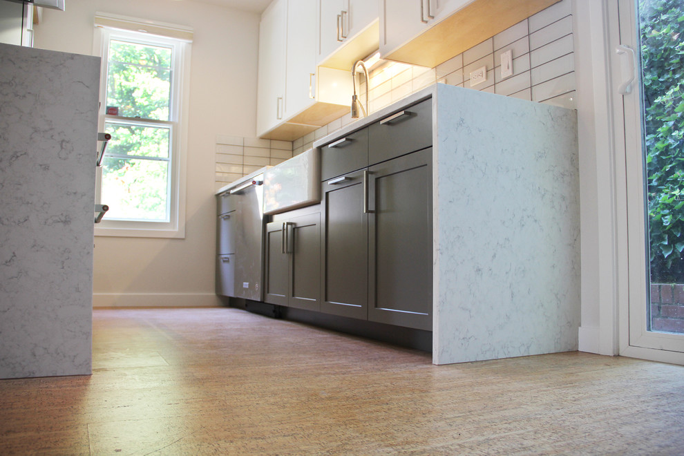 Example of a small minimalist galley medium tone wood floor and brown floor eat-in kitchen design in Portland with an undermount sink, shaker cabinets, white cabinets, marble countertops, white backsplash, subway tile backsplash, stainless steel appliances and no island