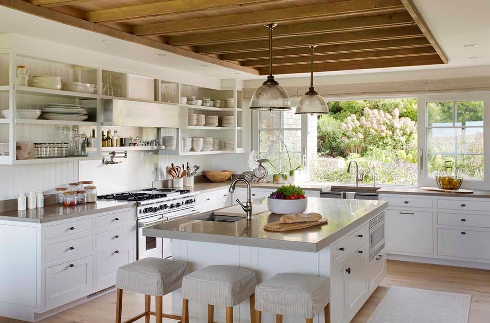 Large cottage l-shaped light wood floor and beige floor enclosed kitchen photo in Boston with open cabinets, white cabinets, metallic backsplash, stainless steel appliances, an island, a farmhouse sink, concrete countertops, metal backsplash and gray countertops