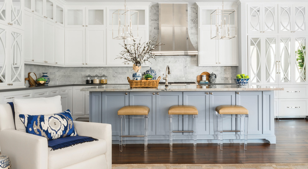 Inspiration for a large transitional l-shaped dark wood floor and brown floor open concept kitchen remodel in Houston with white cabinets, white backsplash, an island, gray countertops, an undermount sink, recessed-panel cabinets and marble backsplash