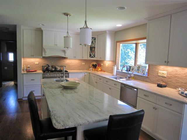 A Sleek Masterpiece traditional-kitchen
