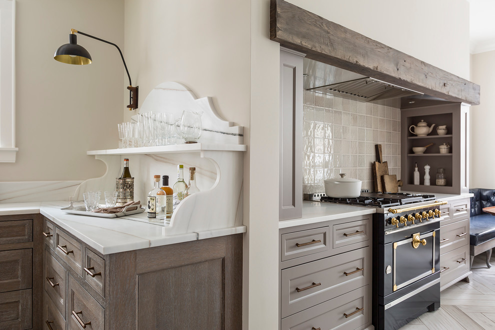 Inspiration for a large transitional porcelain tile eat-in kitchen remodel in Minneapolis with an undermount sink, recessed-panel cabinets, gray cabinets, marble countertops, gray backsplash, ceramic backsplash and black appliances