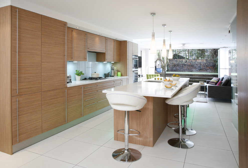 Trendy kitchen photo in London with flat-panel cabinets and light wood cabinets