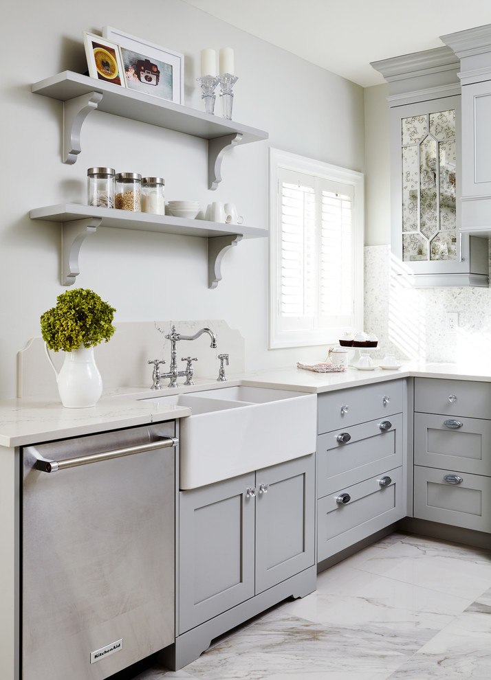 Kitchen - small traditional l-shaped kitchen idea in Toronto with a farmhouse sink, shaker cabinets, gray cabinets and stainless steel appliances