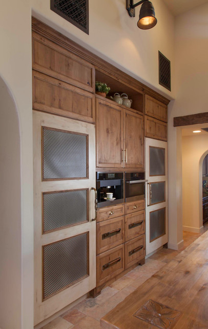 Eat-in kitchen - large mediterranean l-shaped ceramic floor and beige floor eat-in kitchen idea in San Diego with a farmhouse sink, recessed-panel cabinets, medium tone wood cabinets, wood countertops, beige backsplash, mosaic tile backsplash, stainless steel appliances and an island