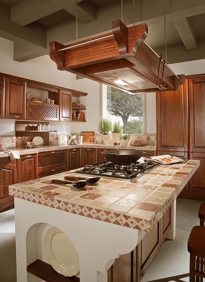 Example of a tuscan kitchen design in Miami with raised-panel cabinets, dark wood cabinets, tile countertops and multicolored countertops