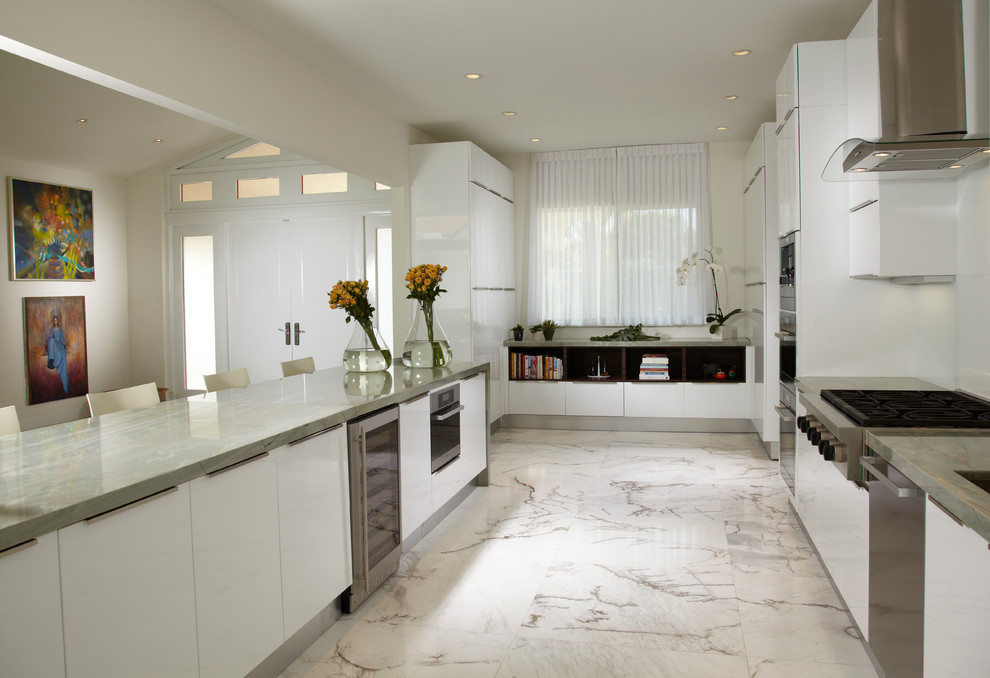 Open concept kitchen - mid-sized contemporary u-shaped marble floor and multicolored floor open concept kitchen idea in Miami with an undermount sink, flat-panel cabinets, white cabinets, marble countertops, glass sheet backsplash, stainless steel appliances and an island