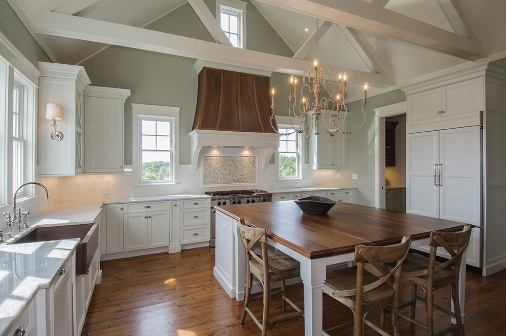 Inspiration for a timeless kitchen remodel in Charleston with a farmhouse sink and wood countertops
