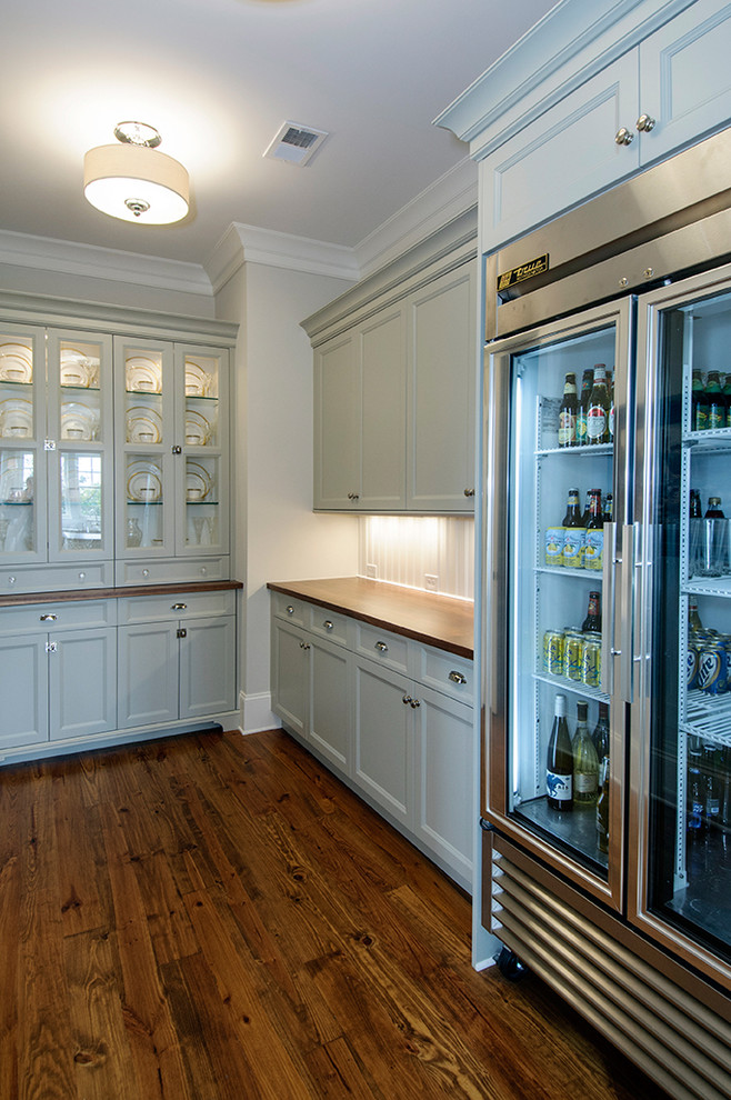 Inspiration for a timeless kitchen remodel in Charleston with stainless steel appliances, wood countertops, recessed-panel cabinets and blue cabinets
