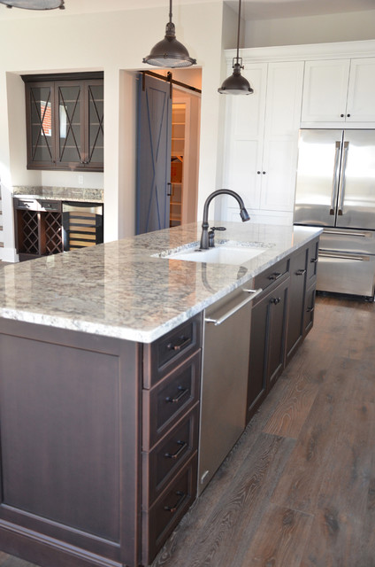 Kitchen - beach style l-shaped dark wood floor kitchen idea in Jacksonville with an undermount sink, shaker cabinets, brown cabinets, granite countertops, stainless steel appliances and an island