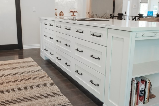 Inspiration for a mid-sized transitional galley dark wood floor eat-in kitchen remodel in Grand Rapids with a farmhouse sink, shaker cabinets, white cabinets, quartz countertops, white backsplash, ceramic backsplash, stainless steel appliances and an island