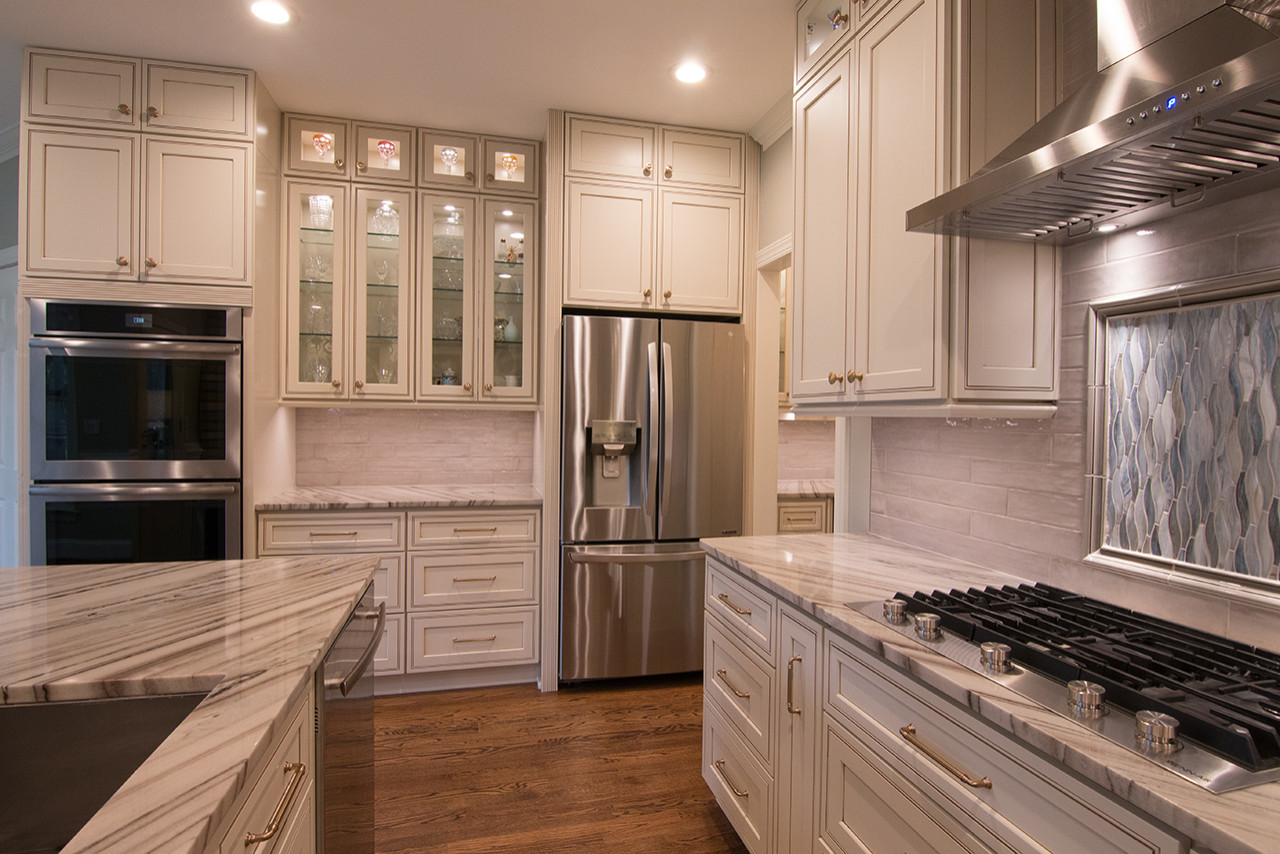 Inspiration for a large timeless l-shaped dark wood floor and brown floor open concept kitchen remodel in Raleigh with an undermount sink, recessed-panel cabinets, white cabinets, granite countertops,