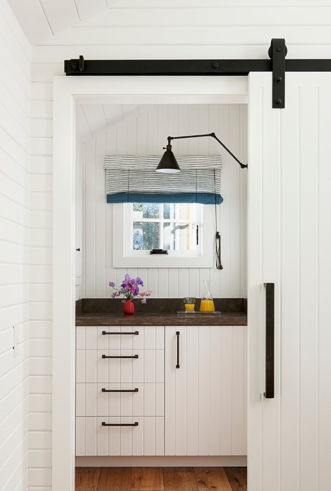 Kitchen - contemporary kitchen idea in San Francisco with white cabinets and wood countertops