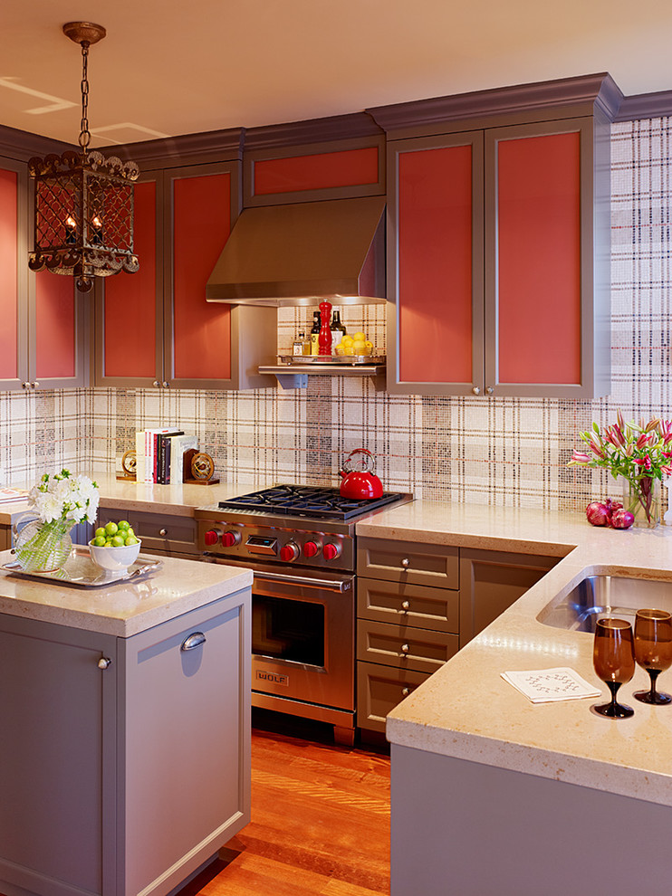 Example of an eclectic kitchen design in San Francisco with recessed-panel cabinets, stainless steel appliances, an undermount sink, red cabinets, concrete countertops and multicolored backsplash