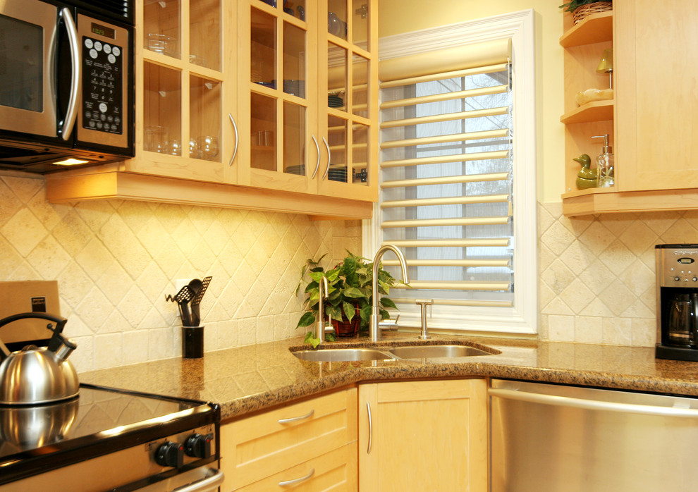 Mid-sized trendy l-shaped eat-in kitchen photo in Toronto with a double-bowl sink, beige backsplash, stainless steel appliances, shaker cabinets, light wood cabinets, granite countertops, stone tile backsplash and an island